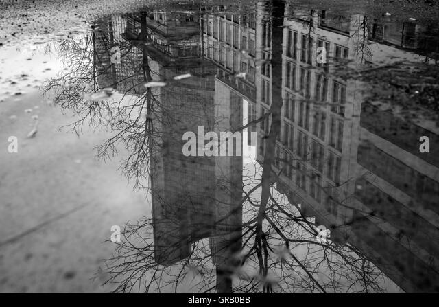 Reflection Of Built Structure In Puddle - Stock Image