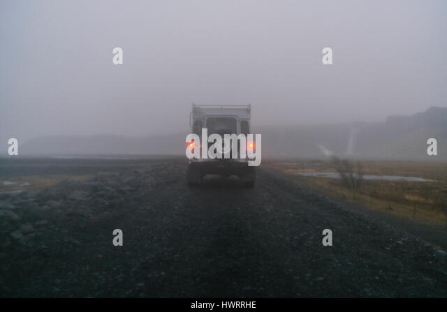 Land Rover driving off road through rugged Icelandic landscape. - Stock Image
