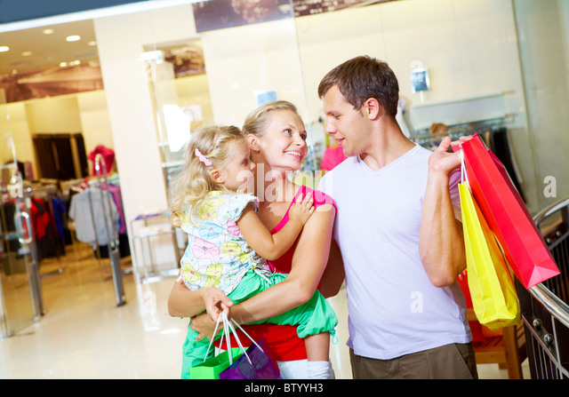 Portrait of happy family spending free time in department store - Stock Image