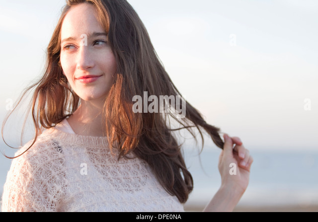 Portrait of young woman on vacation, Whitstable, Kent, UK - Stock-Bilder