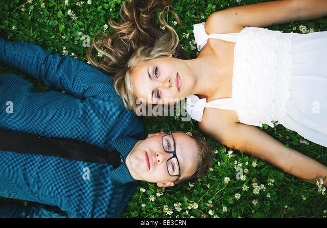 USA, Minnesota, Hennepin County, Minneapolis, Overhead view of young couple lying on grass - Stock Image
