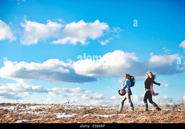 Two mature women enjoying exhilarating walk - Stock Image