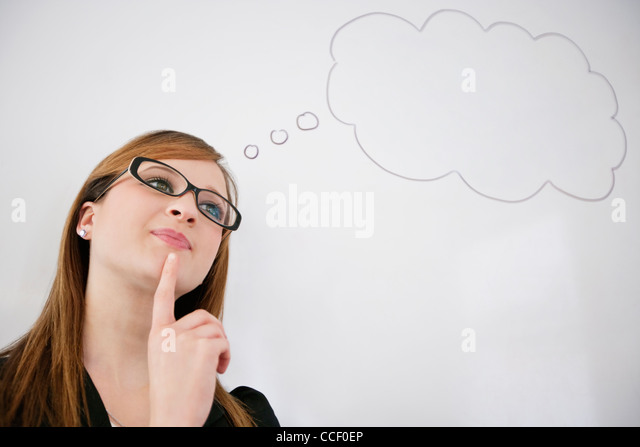 Young woman thinking about future pay rise - Stock Image