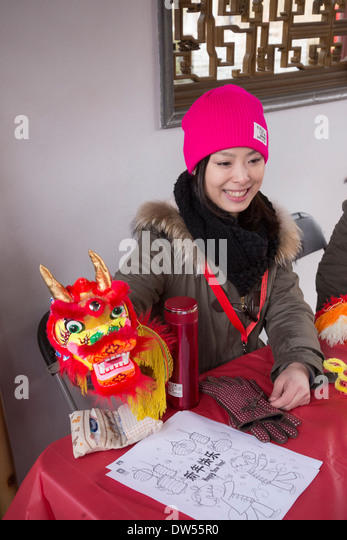 Volunteer at Dr Sun Yat Sen Garden, Chinese New Year Celebration, Vancouver, British Columbia, Canada - Stock Image