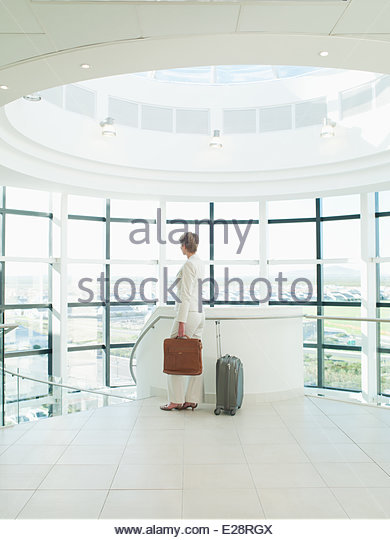 Businesswoman waiting to go on business trip - Stock Image