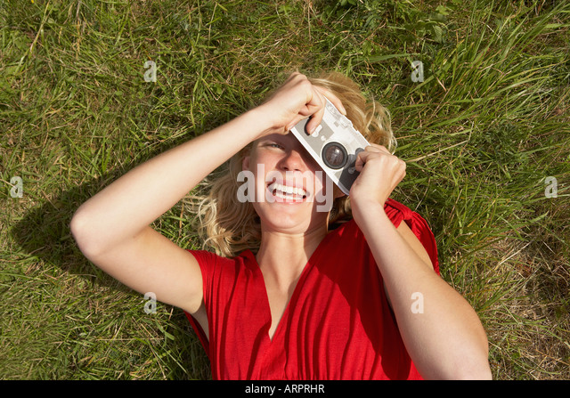 Young woman with fake toy camera - Stock Image