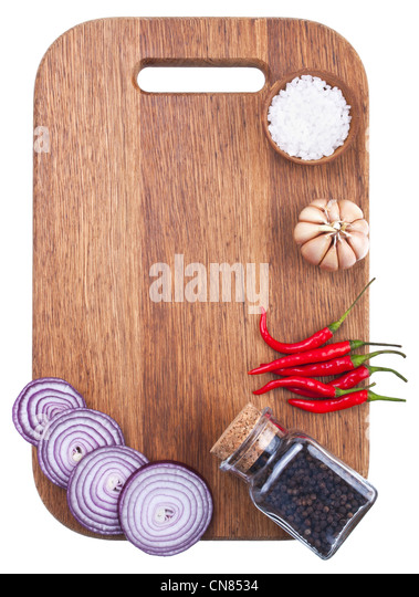 Culinary background with fresh vegetables on cutting board - Stock Image