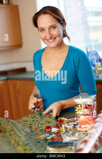 Woman with Christmas paper - Stock Image