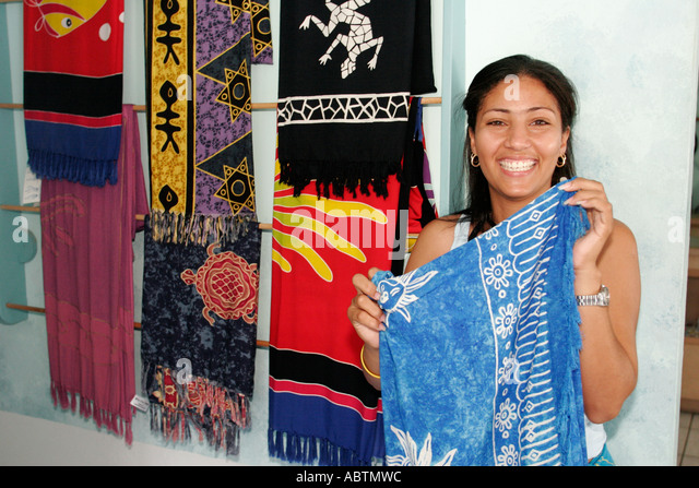Grand Turk Cockburn Town Duke Street Black woman store manager scarves - Stock Image