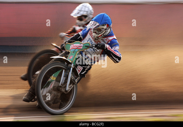 Speedway racing at Svansta race track in Nyköping, Sweden. Biker from team Griparna in the front. - Stock Image