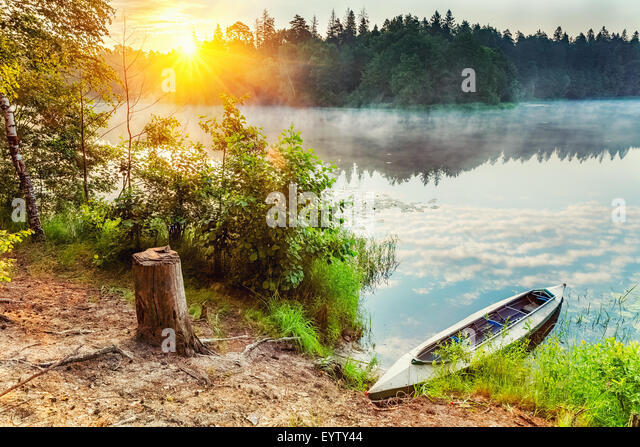Canoe on a lake - Stock Image