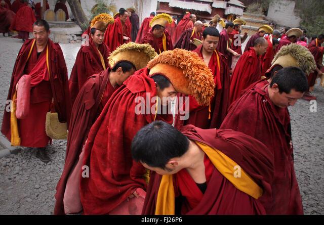 Tibetan monks debating at Jokhang temple, Lhasa, Tibet - Stock Image