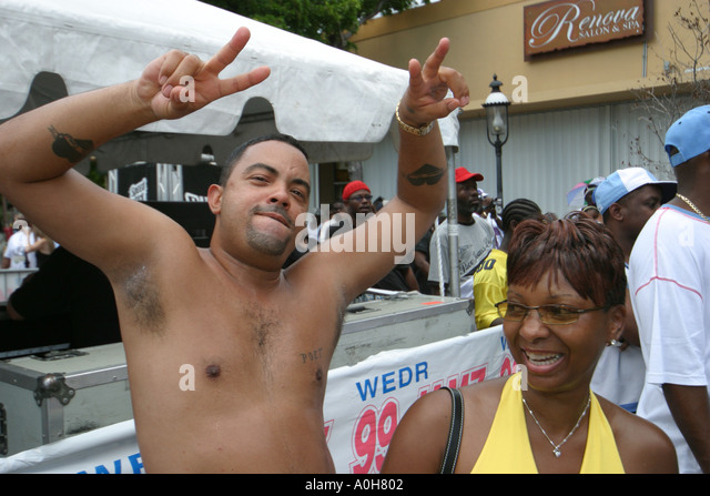 Coconut Grove Florida Grand Avenue Bahamas Goombay Festival Black Hispanic couple dancing music - Stock Image