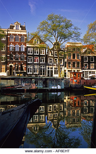 Netherlands Amsterdam Reflection of building in canal called Brouwersgracht - Stock-Bilder