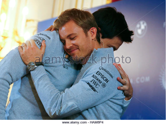 Mercedes' Formula One World Champion Nico Rosberg of Germany hugs Mercedes Executive Director Toto Wolff during - Stock-Bilder
