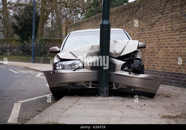 Car Volvo S80 D5 which has crashed into a lamp post UK - Stock Image