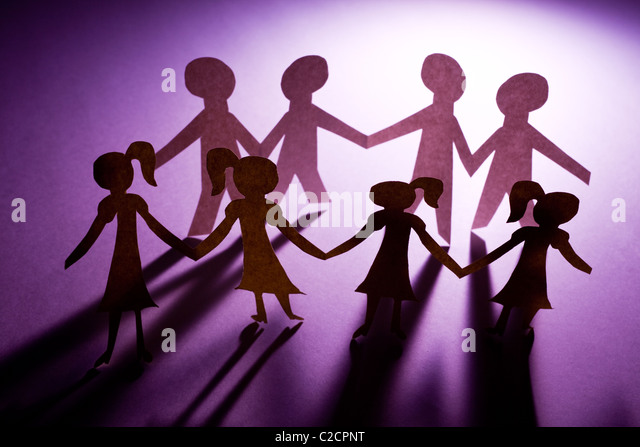 Paper Chain girls and boys, concept of Teamwork - Stock Image