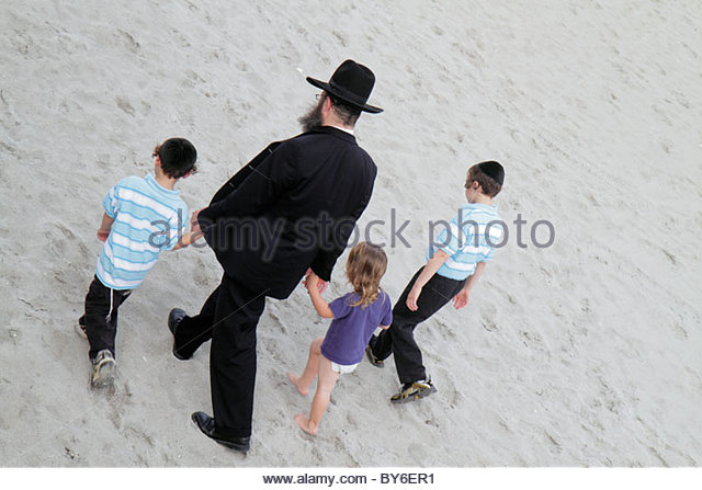 Boca Raton Florida public beach Atlantic Ocean Orthodox Jews family man father children boy girl - Stock Image