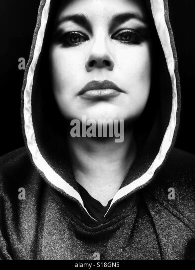 Expressive black and white portrait young woman looking at camera - Stock-Bilder