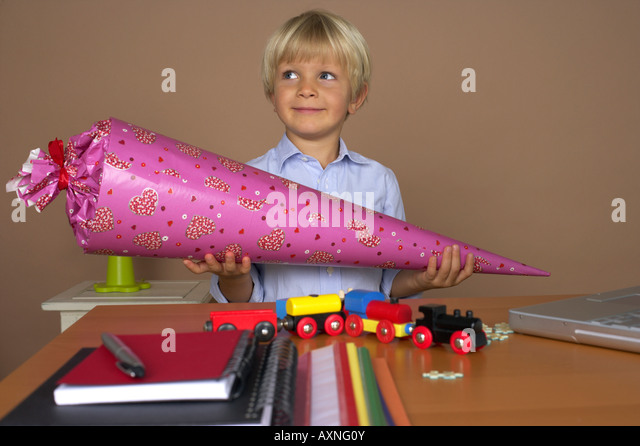 Boy (4-5 Years) holding a decorative cone - Stock Image