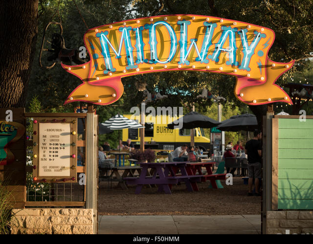 A neon sign at the Midway food truck park's in Austin,Texas - Stock Image