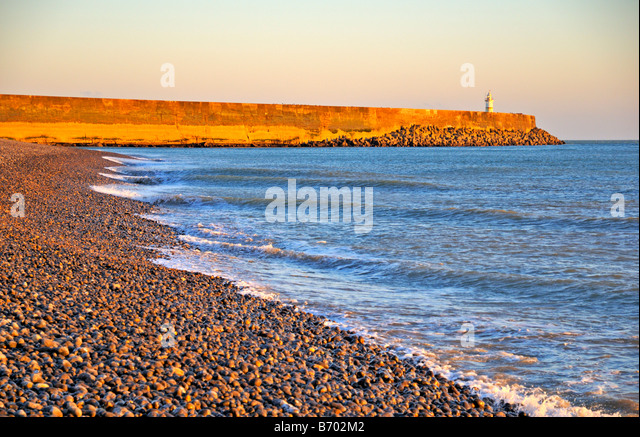 Newhaven west beach and lighthouse East Sussex United Kingdom - Stock Image