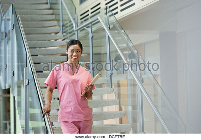 Nurse walking with files - Stock Image