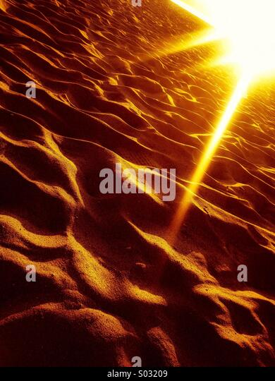 Sunrise on sand - Stock-Bilder