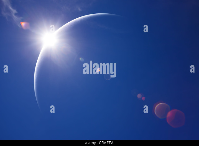 Partial Solar Eclipse with blue sky and lens flare (Digital art) - Stock-Bilder