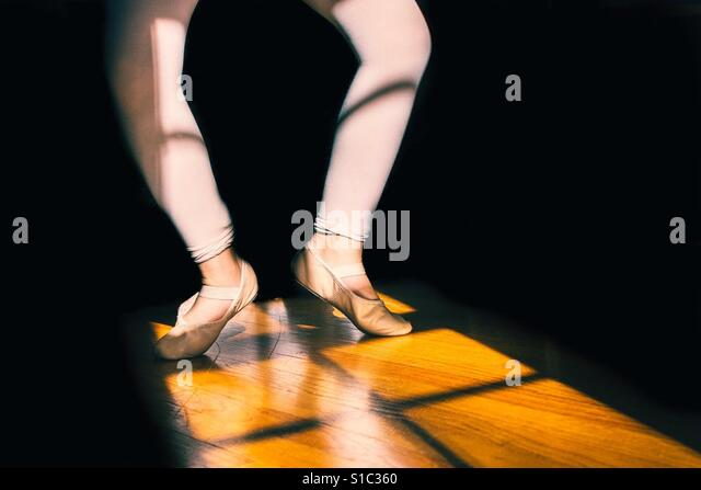 Young girl child practicing ballet with close up on feet - Stock-Bilder