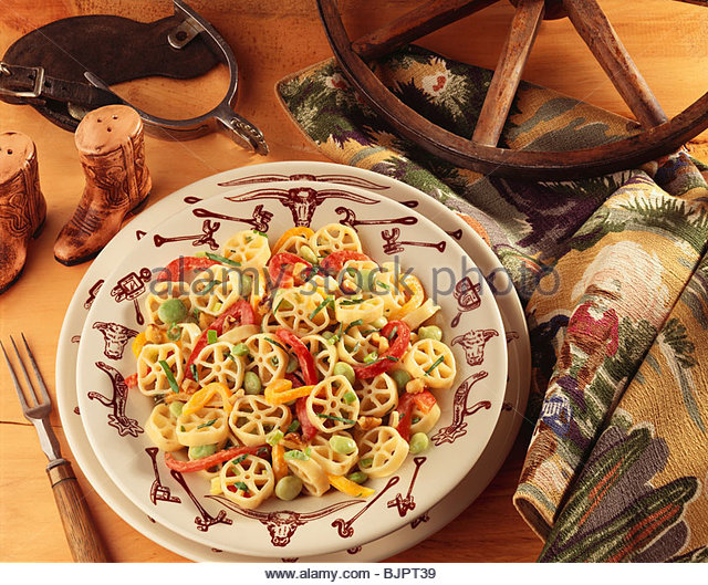 Rotelle Pasta with Red and Yellow Bell Peppers and Lima Beans; Western Decorations - Stock Image