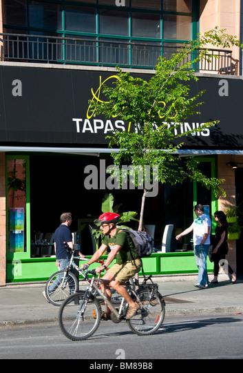 Cyclist Boulevard Saint Laurent Montreal - Stock Image