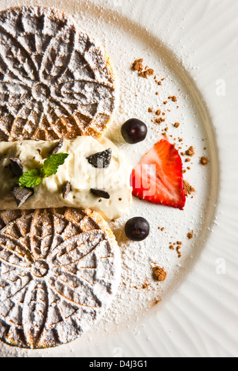 Homemade wafers with ricotta cream prepared by Marcello Russodivito, Chef Owner of Marcello's Group. - Stock Image