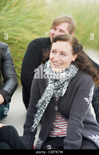 Smiling mid adult woman with friends on vacations - Stock Image