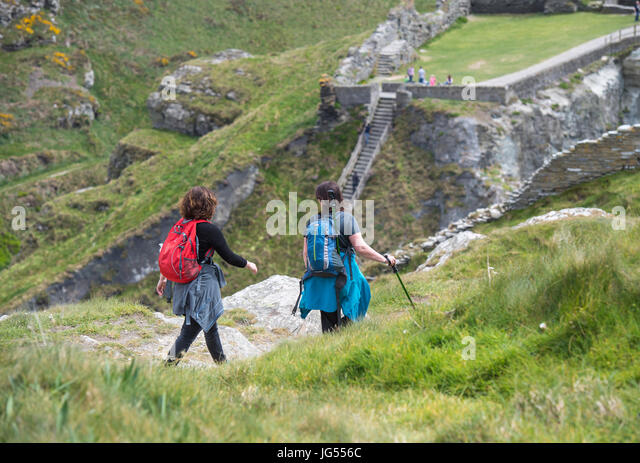 Tourists visiting Tintagel in Cornwall, England, UK - Stock Image