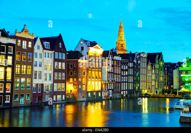 Night city view of Amsterdam, the Netherlands with canal - Stock Image