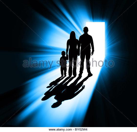 Family silhouette in doorway - Stock-Bilder