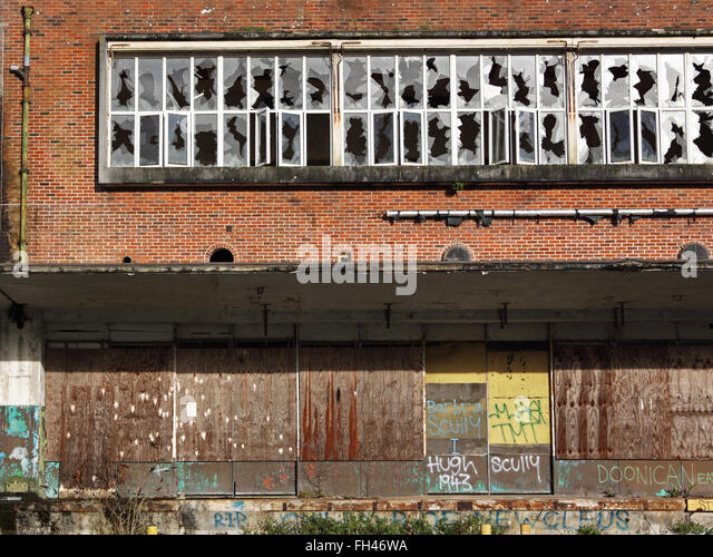 Boarded up abandoned industrial premises UK - Stock Image