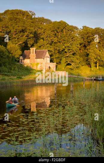 Canoeing below the Crom Castle Boathouse along Upper Lough Erne, Northern Ireland, UK - Stock Image