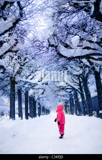 Child in snowy park - Stock Image