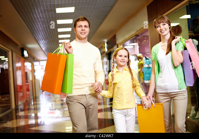 Image of family spending their time in the mall - Stock Image