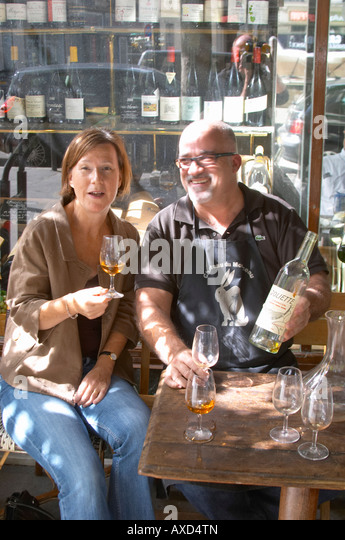 Britt Karlsson, BKWine, outside Cave Auge wine shop with the manager Marc Sibard, Paris, France. - Stock Image