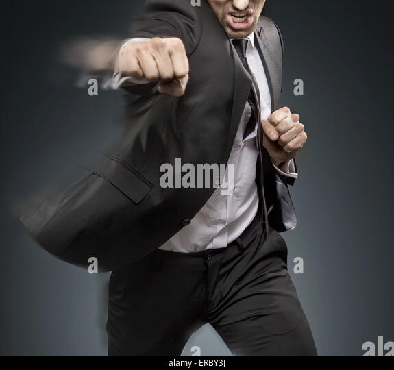 Handsome businessman defeating an another challenger - Stock Image