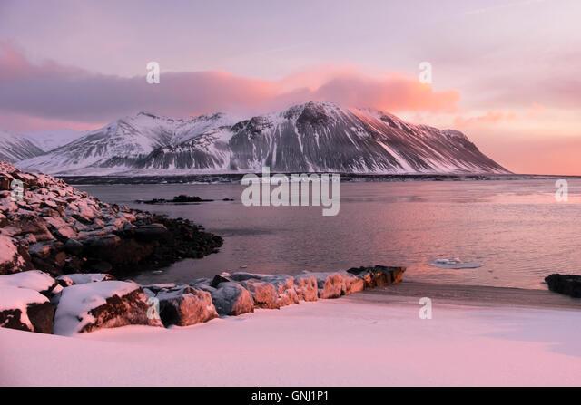 Winter sunset at Borgarnes, looking towards Hafnarfjall, Iceland - Stock Image