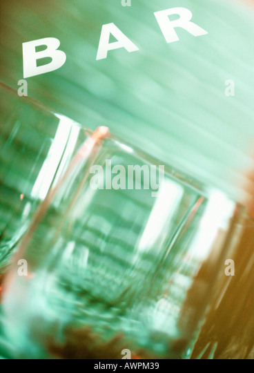 Glasses and 'bar' text, close-up, blurred - Stock Image