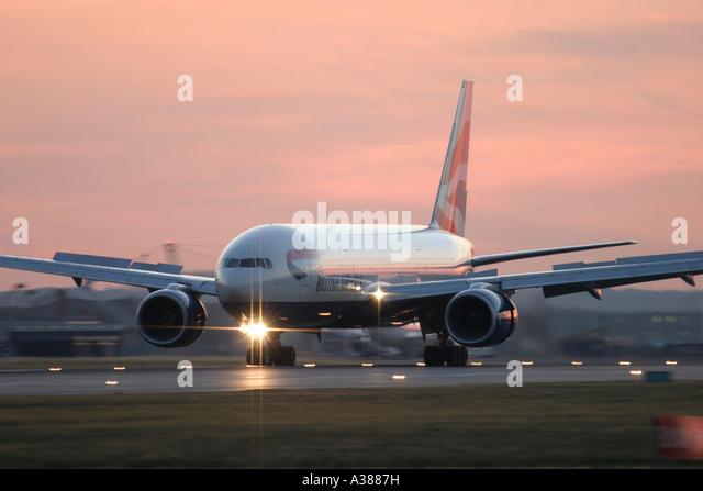 British Airways Boeing 777 slowing down after landing at London Heathrow Airport - Stock Image
