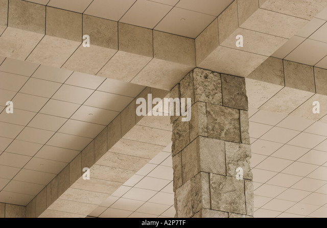 A stone and tile pillar supporting the ceiling of a building at the J. Paul Getty Museum in Los Angeles, CA. - Stock Image
