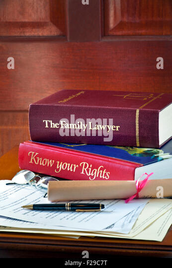 Legal concept of home consumer reference legal advice books and legal letters and correspondence on leather bound - Stock Image