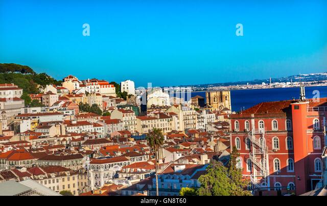 Belevedere Miradoura de Sao Pedro de Alcantara Outlook Cathedral Houses Harbor Lisbon Portugal - Stock Image