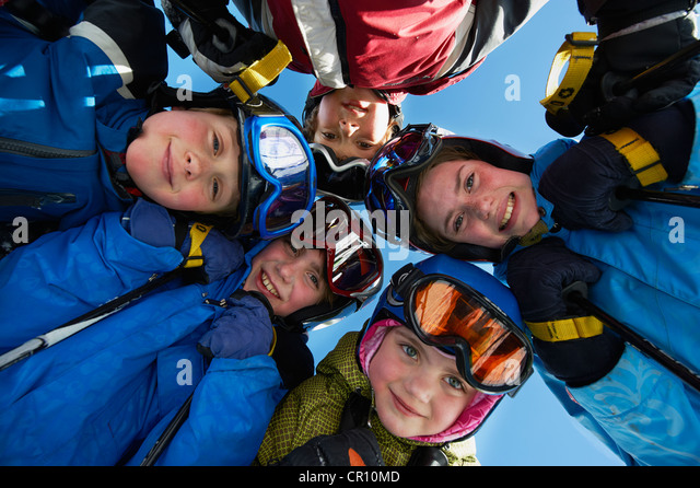 Children in ski gear standing together - Stock Image